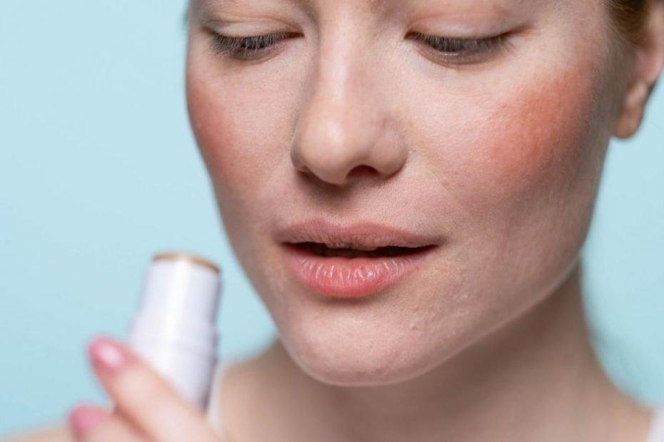 A women applying lip balm on lips